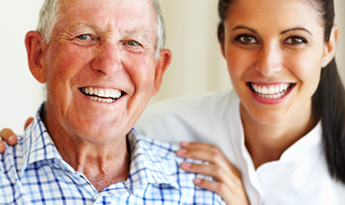 Smiling Man and Caregiver